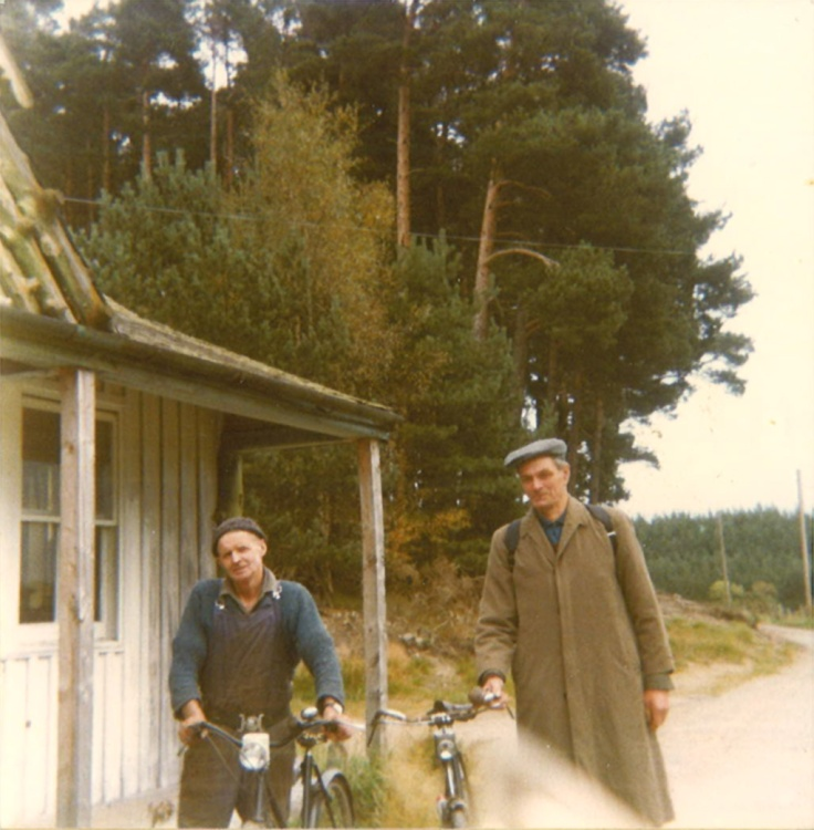 My Dad (right) holding up his bike with my Uncle (left)